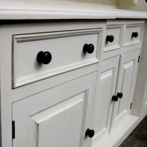 White dresser and black handles